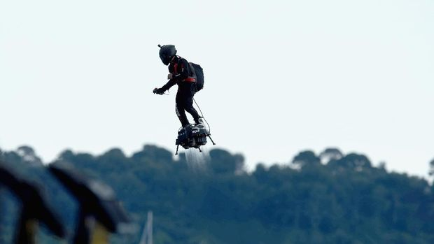 CANNES, FRANCE - MAY 15:  A man jetpacks over the screening of