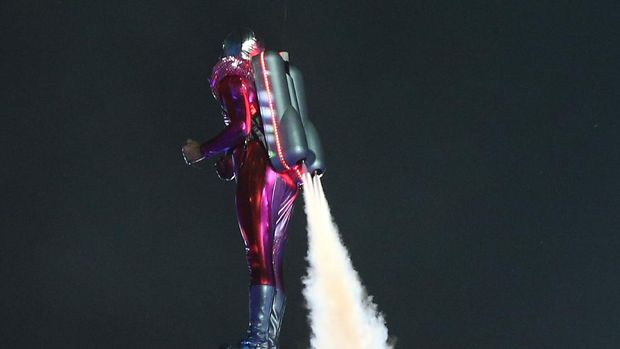 LONDON, ENGLAND - JULY 27: A performer with a jetpack takes part in the Opening Ceremony of the London 2012 Olympic Games at the Olympic Stadium on July 27, 2012 in London, England.  (Photo by Cameron Spencer/Getty Images)