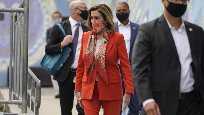 House Speaker Nancy Pelosi walks with her staff to a news conference at the Mission Education Center Elementary School, Wednesday, Sept. 2, 2020, in San Francisco. Pelosi said she takes responsibility for trusting the word of a San Francisco hair salon shes visited over the years when it told her it was OK to come in for a solo visit this week, even though the city still does not allow indoor beauty services. (AP Photo/Eric Risberg)