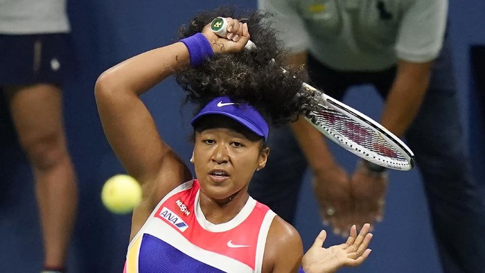 Naomi Osaka, of Japan, returns a shot to Camila Giorgi, of Italy, during the second round of the U.S. Open tennis championships, Wednesday, Sept. 2, 2020, in New York. (AP Photo/Frank Franklin II)