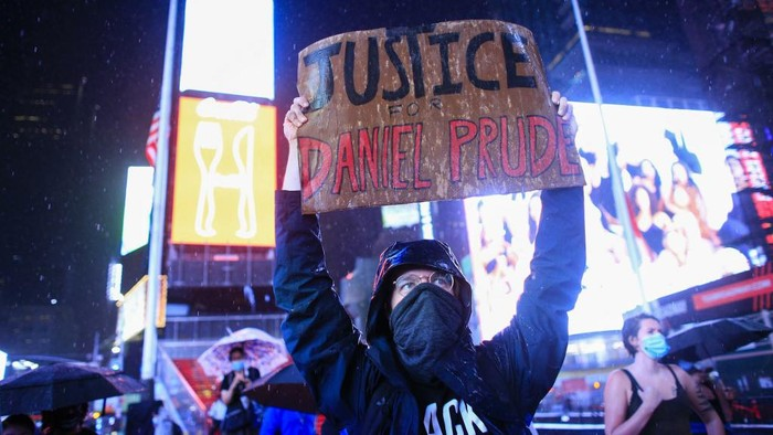 A demonstrator holds a sign during a protest to demand justice for Daniel Prude, on September 3, 2020 in New York City. - Protests were planned in New York September 3 over the death of Daniel Prude, a black man that police hooded and forced face down on the road, according to video footage that prompted a probe from the states attorney general. (Photo by Kena Betancur / AFP)