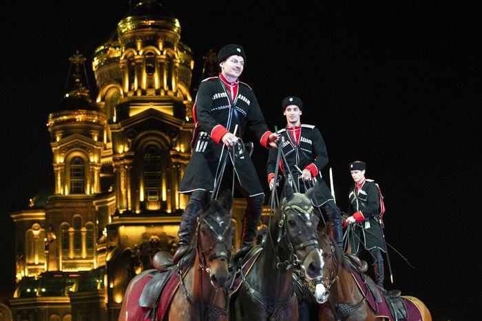 Russian Navy band performs during the Spasskaya Tower military music festival in front of the Cathedral of Russian Armed Forces in Kubinka, outside Moscow, Russia, Sunday, Sept. 6, 2020. Due to coronavirus, the annual international music festival in Red Square was canceled, an online festival without spectators took place Sunday on the Cathedral Square in Patriot Park, outside Moscow. (AP Photo/Pavel Golovkin)