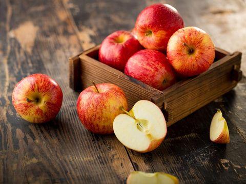 apple isolated on wood background