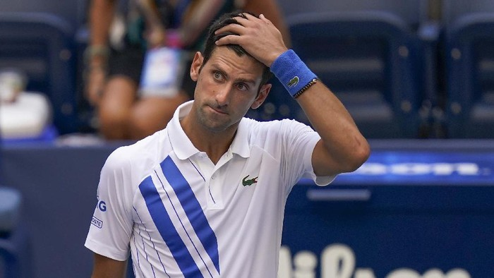 Novak Djokovic, of Serbia, leaves the court after defaulting the match to Pablo Carreno Busta, of Spain, during the fourth round of the US Open tennis championships, Sunday, Sept. 6, 2020, in New York. Djokovic inadvertently hit a line judge with a ball after hitting it in reaction to losing a point against Carreno Busta. (AP Photo/Seth Wenig)