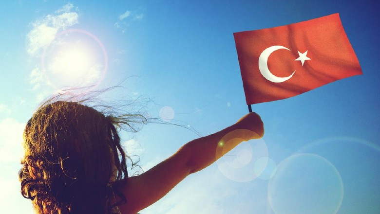 Little girl waving Turkish flag on sunny beautiful day