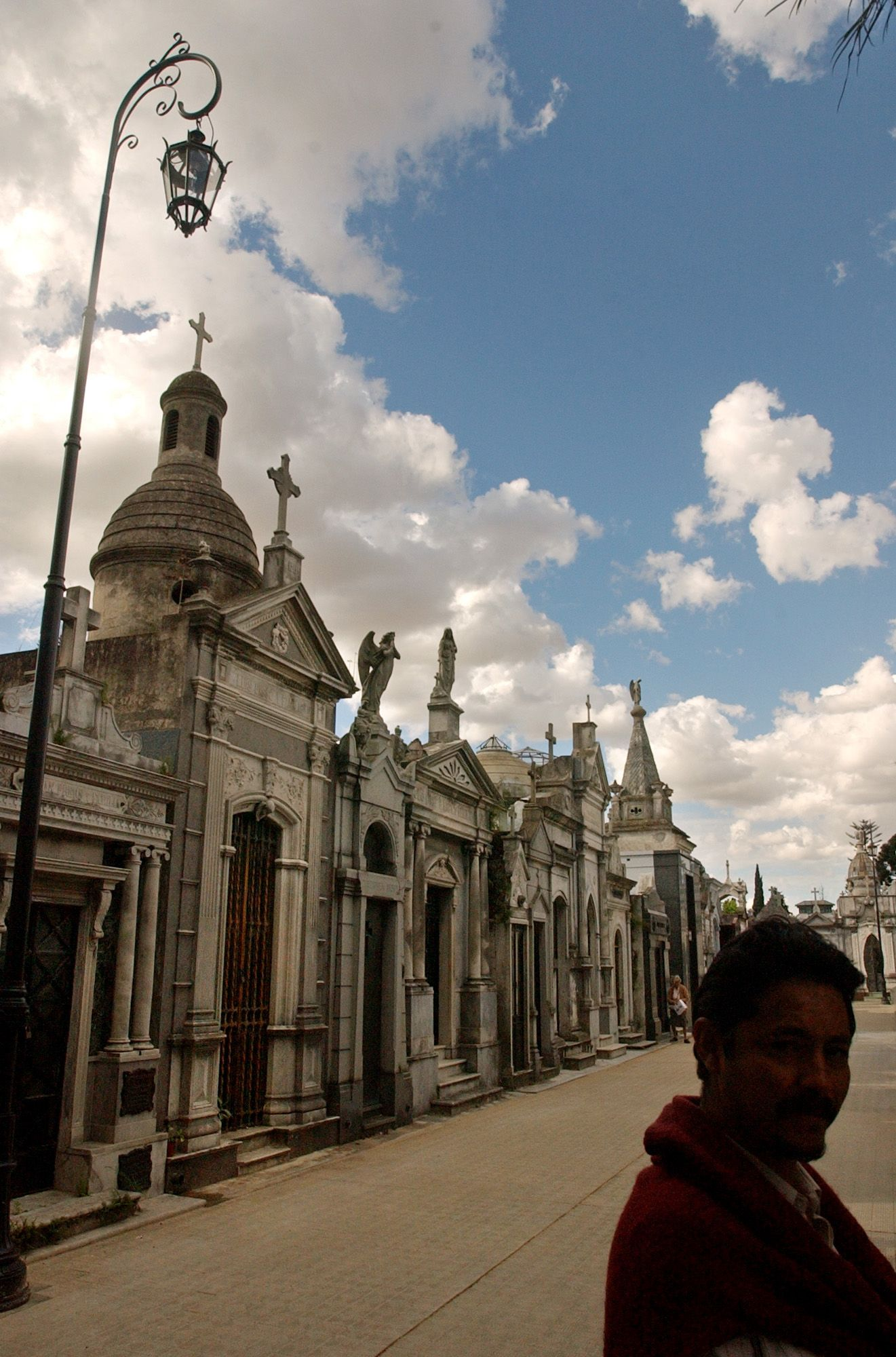 Tourists arrive to Recoleta cemetery,  the posh resting place for Buenos Aires' rich and powerful, to visit the tomb of Evita Peron, the wife of former Argentina's strongman Juan Peron, Nov. 19, 2003.  Evita's tomb, like Gardel's, has become something of a shrine. (AP Photo/Natacha Pisarenko)