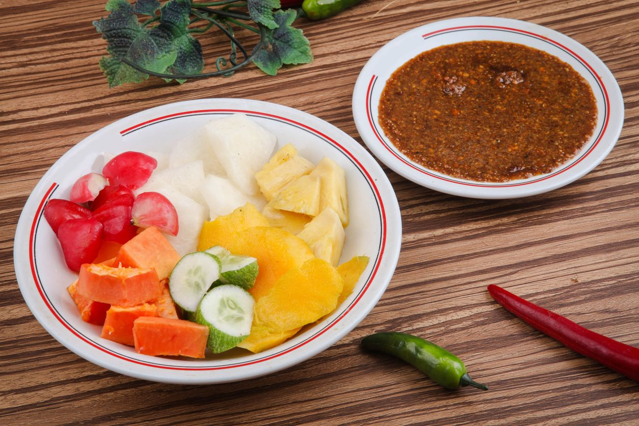 Rujak Buah or Rujak is a traditional Indonesian food, from fruit that is cut into pieces with brown sugar sauce and peanuts as a companion