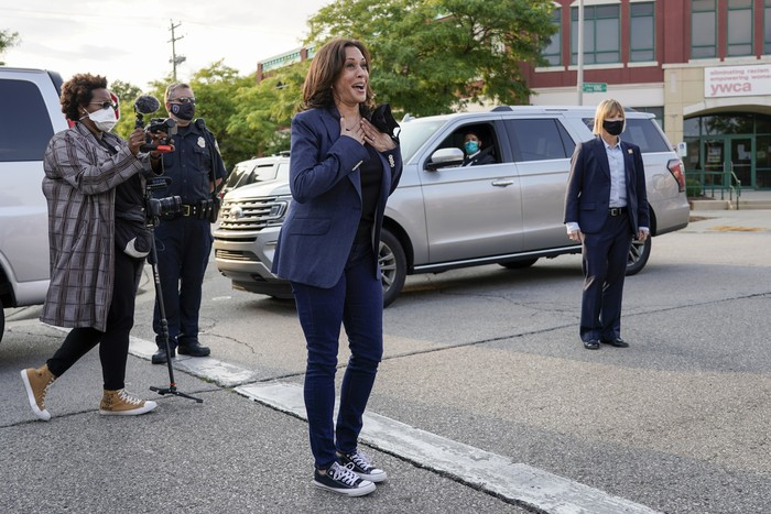 Democratic vice presidential candidate Sen. Kamala Harris, D-Calif., waves before boarding her plane after a campaign stop Monday, Sept. 7, 2020, in Milwaukee. (AP Photo/Morry Gash)