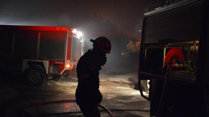 Fire burns container houses and tents in the Moria refugee camp on the northeastern Aegean island of Lesbos, Greece, on Wednesday, Sept. 9, 2020. A fire swept through Greeces largest refugee camp that had been placed under COVID-19 lockdown, leaving more than 12,000 migrants in emergency need of shelter on the island of Lesbos. (AP Photo/Panagiotis Balaskas)