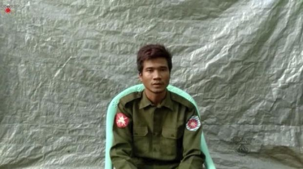In this image taken from video provided by the Arakan Army, Private Zaw Naing Tun provides a video testimony from an undisclosed location somewhere in Myanmar on July 8, 2020. Two soldiers who deserted from Myanmar's army have testified on video that they were instructed by commanding officers to