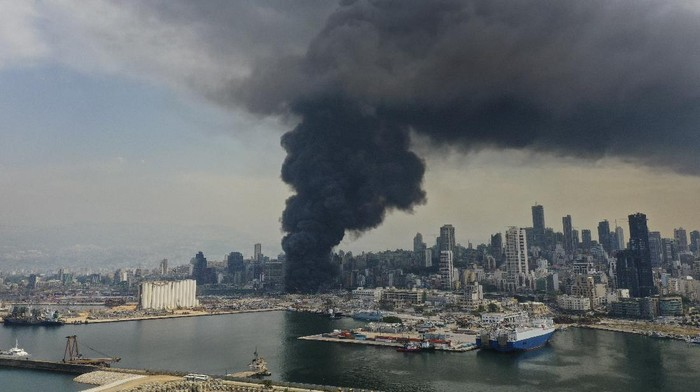 Black smoke rises from a fire at warehouses at the seaport in Beirut, Lebanon, Thursday, Sept. 10. 2020. A huge fire broke out Thursday at the Port of Beirut, triggering panic among residents traumatized by last months massive explosion that killed and injured thousands of people. (AP Photo/Hussein Malla)