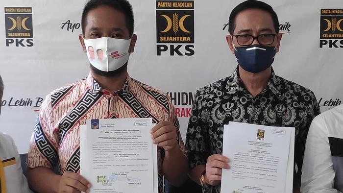 Pasangan Bakal Calon Bupati Maros, Harmil Mattorang (kiri) bersama Wakilnya, Ilham Nadjamuddin.