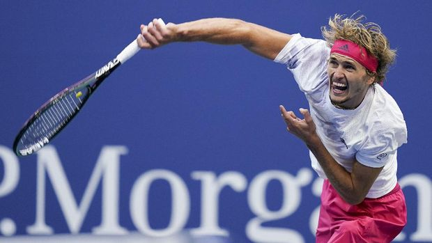 Alexander Zverev, of Germany, serves to Pablo Carreno Busta, of Spain, during a men's semifinal match of the US Open tennis championships, Friday, Sept. 11, 2020, in New York. (AP Photo/Seth Wenig)