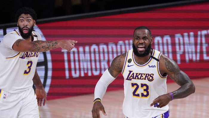 Los Angeles Lakers LeBron James, right, and Anthony Davis argue a call during the first half of an NBA conference semifinal playoff basketball gameagainst the Houston Rockets Saturday, Sept. 12, 2020, in Lake Buena Vista, Fla. (AP Photo/Mark J. Terrill)