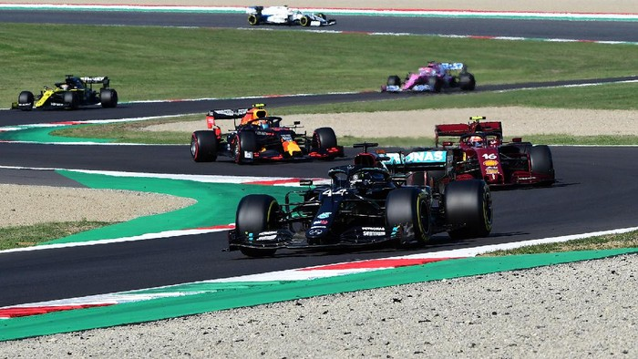 SCARPERIA, ITALY - SEPTEMBER 13: Lewis Hamilton of Great Britain driving the (44) Mercedes AMG Petronas F1 Team Mercedes W11 leads Charles Leclerc of Monaco driving the (16) Scuderia Ferrari SF1000 on track during the F1 Grand Prix of Tuscany at Mugello Circuit on September 13, 2020 in Scarperia, Italy. (Photo by Jenifer Lorenzini - Pool/Getty Images)