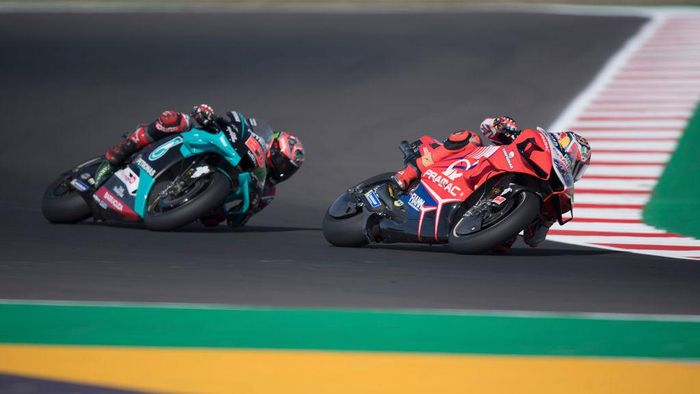 MISANO ADRIATICO, ITALY - SEPTEMBER 11: Jack Miller of Australia and Pramac Racing leads Fabio Quartararo of France and Petronas Yamaha SRT during the MotoGP Of San Marino - Free Practice at Misano World Circuit on September 11, 2020 in Misano Adriatico, Italy. (Photo by Mirco Lazzari gp/Getty Images)