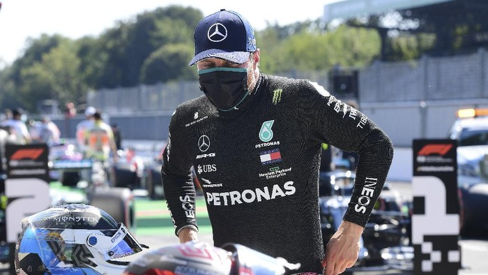 Mercedes driver Valtteri Bottas of Finland stands after clocking the second fastest time during the qualifying session for Sundays Italian Formula One Grand Prix, at the Monza racetrack in Monza, Italy, Saturday, Sept. 5, 2020. (Jennifer Lorenzini/Pool via AP)
