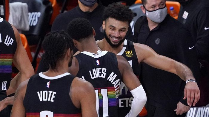 Denver Nuggets Jamal Murray, right, celebrates with Monte Morris (11) after an NBA conference semifinal playoff basketball against the Los Angeles Clippers game Sunday, Sept. 13, 2020, in Lake Buena Vista, Fla. The Nuggets won 111-98. (AP Photo/Mark J. Terrill)
