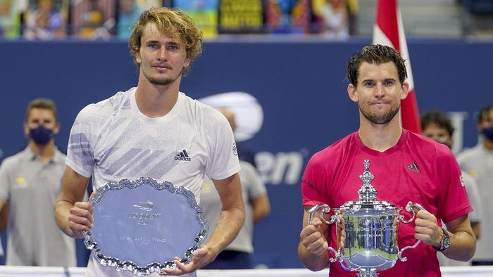 Dominic Thiem, of Austria, holds up the championship trophy after defeating Alexander Zverev, of Germany, in the mens singles final of the US Open tennis championships, Sunday, Sept. 13, 2020, in New York. (AP Photo/Seth Wenig)