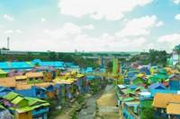 Kampung Jodipan yang sering kita dengar sebagai kampung warna-warni. Terletak di tengah Kota Malang, tidak jauh dari Stasiun Kota Malang. (Foto: Joel Wakanno/dtraveler)