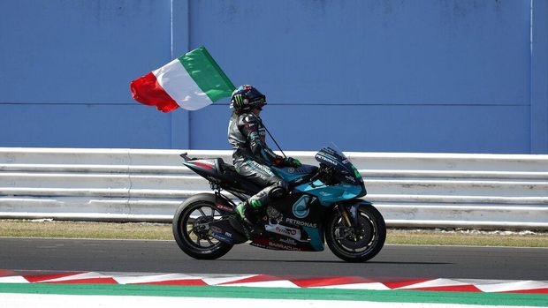MotoGP rider Valentino Rossi of Italy takes a curve during the San Marino Motorcycle Grand Prix at the Misano circuit in Misano Adriatico, Italy, Sunday, Sept. 13, 2020. (AP Photo/Antonio Calanni)