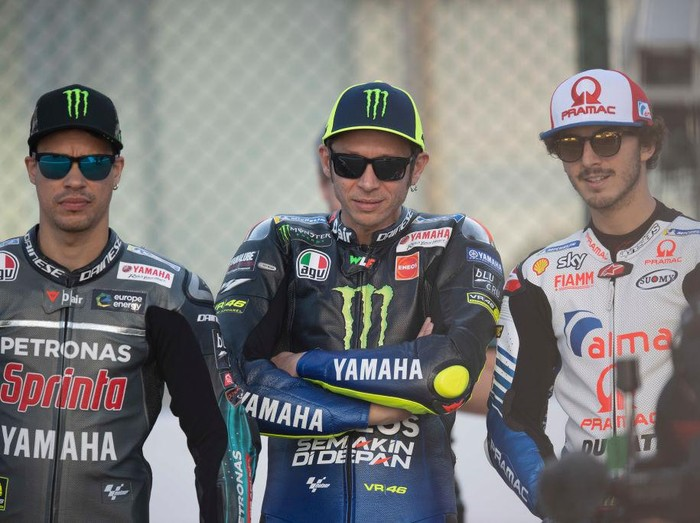 DOHA, QATAR - MARCH 07: (L-R) Franco Morbidelli of Italy and Petronas Yamaha SRT,  Valentino Rossi of Italy and Yamaha Factory Racing and Francesco Bagnaia of Italy and Alma Pramac Racing pose on track during MotoGP of Qatar - Previews at Losail Circuit on March 07, 2019 in Doha, Qatar. (Photo by Mirco Lazzari gp/Getty Images)