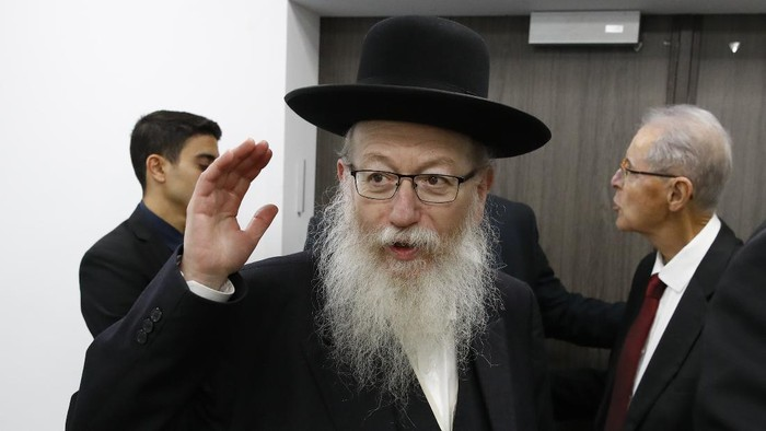 FILE - In this Feb. 23, 2020 file photo, Israeli Health Minister Yaakov Litzman arrives for a situation assessment meeting regarding the Coronavirus, in Tel Aviv, Israel. Housing Minister Yaakov Litzman, who served as health minister during the initial outbreak of the virus, resigned Sunday, Sept 13, 2020, in protest over the government's plan to impose a nationwide lockdown this week ahead of the Jewish New Year due to rising coronavirus cases. (Jack Guez/Pool via AP, File)