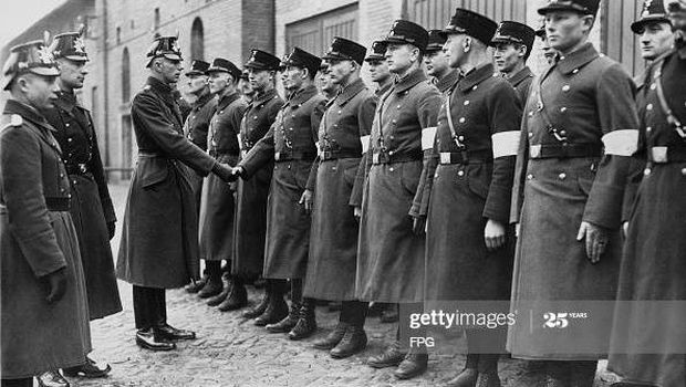 SS or Schutzstaffel officers are sworn in as auxiliary police officers at Potsdam, Germany, 3rd March 1933.  (Photo by FPG/Getty Images)