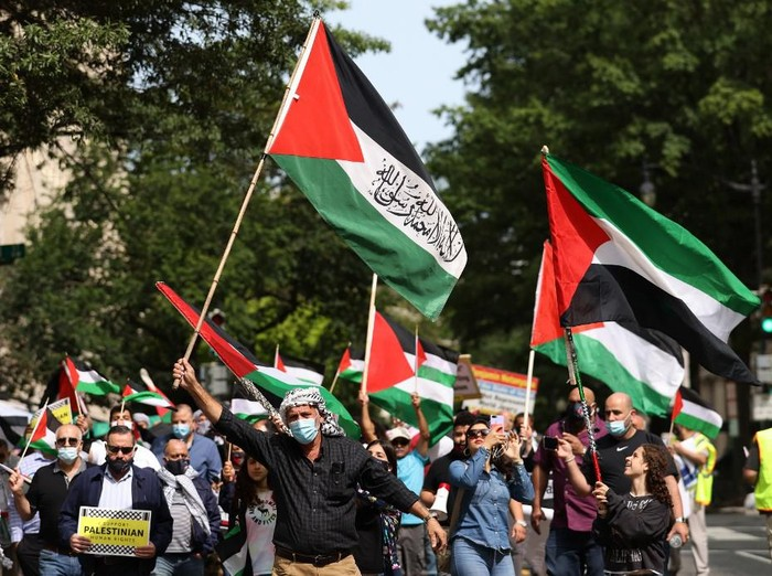 WASHINGTON, DC - SEPTEMBER 15: Protesters from multiple Palestinian rights organizations march outside the White House on September 15, 2020 in Washington, DC. The groups gathered to protest the signing of the Abraham Accords that will normalize relations between Israel, Bahrain and the United Arab Emirates.   Win McNamee/Getty Images/AFP