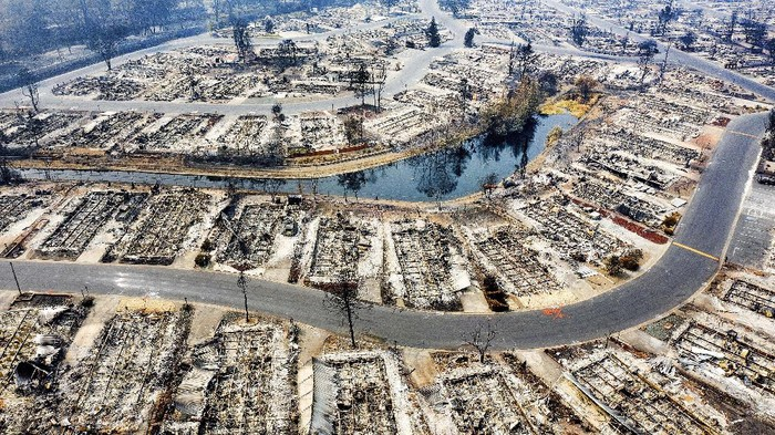 In this photo taken by a drone, homes leveled by the Almeda Fire line the Bear Lake Estates in Phoenix, Ore., Tuesday, Sept. 15, 2020. (AP Photo/Noah Berger)