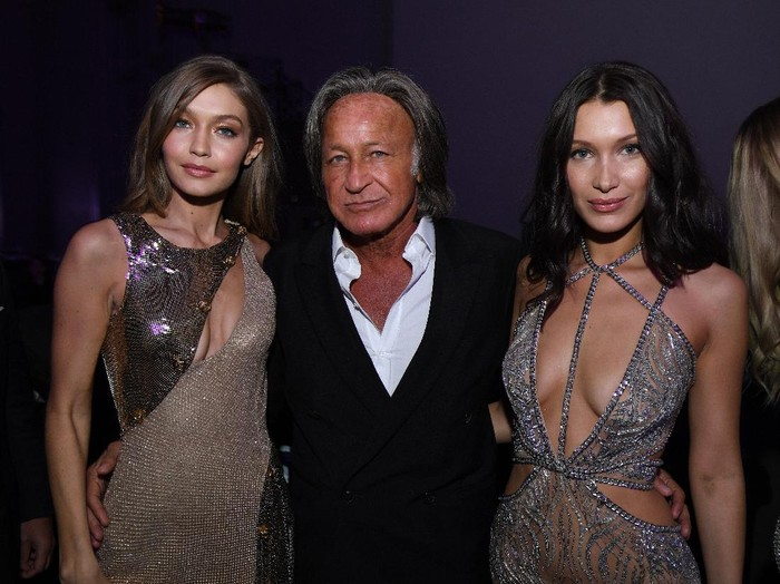 PARIS, FRANCE - NOVEMBER 30:  (L-R) Gigi Hadid, Mohamed Hadid and Bella Hadid attend the Victorias Secret After Party at the Grand Palais on November 30, 2016 in Paris, France.  (Photo by Dimitrios Kambouris/Getty Images for Victorias Secret)