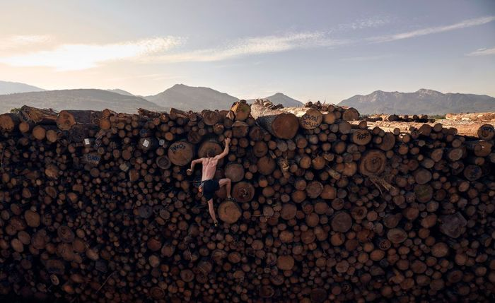 KOCHEL AM SEE, GERMANY - SEPTEMBER 15: Georg Filser-Mayerhofer of Germany climbs a log pile while doing some bouldering training in Kochel on September 15, 2020 in Kochel Am See, Germany. (Photo by Adam Pretty/Getty Images)