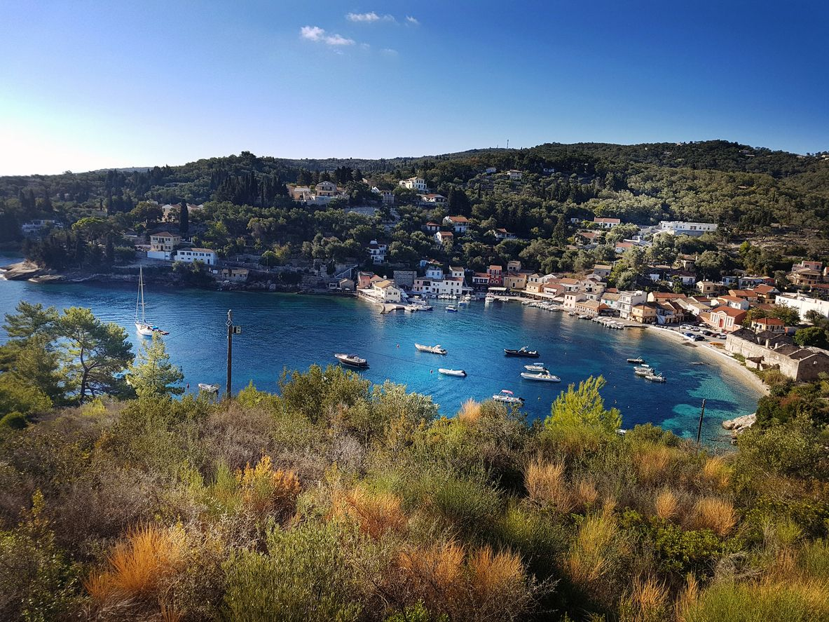 View of the bay of Paxos with yachts and the sun