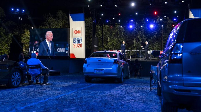 Democratic presidential candidate former Vice President Joe Biden ]is seen on a video screen as he participates in a CNN town hall moderated by Anderson Cooper in Moosic, Pa., Thursday, Sept. 17, 2020. (AP Photo/Carolyn Kaster)