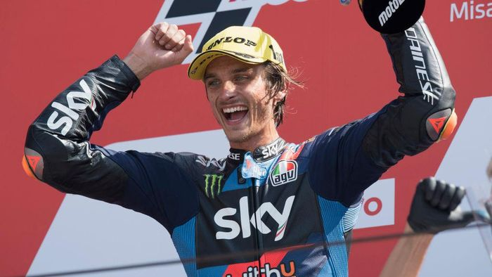 MISANO ADRIATICO, ITALY - SEPTEMBER 13: Luca Marini of Italy and Sky Racing Team VR46  celebrates the victory on the podium at the end of the Moto2 race during the MotoGP Of San Marino - Race at Misano World Circuit on September 13, 2020 in Misano Adriatico, Italy. (Photo by Mirco Lazzari gp/Getty Images)