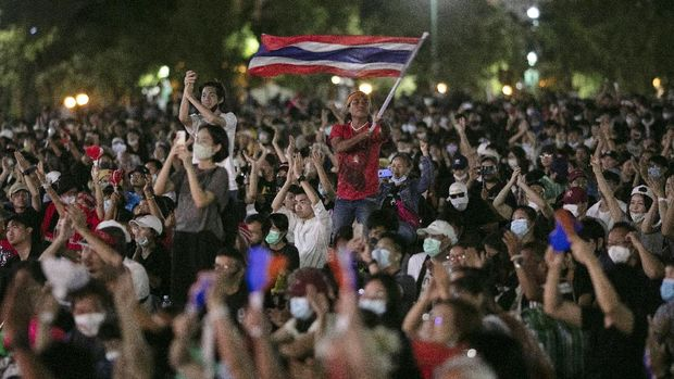 Pro-democracy protesters wave the national flag at the Sanam Luang field during a protest in Bangkok, Thailand, Saturday, Sept. 19, 2020. Thousands of demonstrators turned out Saturday for a rally to support the student-led protest movement's demands for new elections and reform of the monarchy. (AP Photo/Wason Wanichakorn)