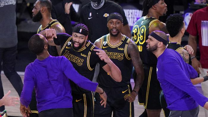 Los Angeles Lakers Anthony Davis, second from left, celebrates with teammates after an NBA conference final playoff basketball game against the Denver Nuggets Sunday, Sept. 20, 2020, in Lake Buena Vista, Fla. The Lakers won 105-103. (AP Photo/Mark J. Terrill)