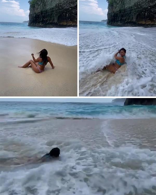 Mau pose di pantai yang cantik eh malah diterjang ombak besar.