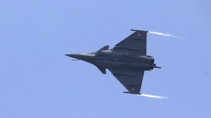 A French-made Rafale fighter jet flies during its induction ceremony at the Indian Air Force Station in Ambala, India, Thursday, Sept.10, 2020. The first batch of five planes, part of a $8.78 billion deal signed between the two countries in 2016 had arrived here in July. (AP Photo/Manish Swarup)