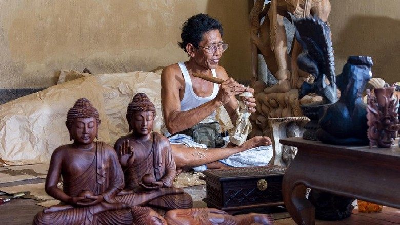 A man is making wooden crafts  in Indonesia