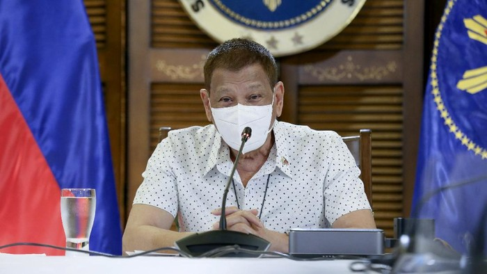 In this photo provided by the Malacanang Presidential Photographers Division, Philippine President Rodrigo Duterte wears a protective mask as he meets members of the Inter-Agency Task Force on the Emerging Infectious Diseases in Davao province, southern Philippines on Monday Sept. 21, 2020. Duterte says he has extended a state of calamity in the entire Philippines by a year to allow the government to draw emergency funds faster to fight the COVID-19 pandemic and harness the police and military to maintain law and order. (Albert Alcain/Malacanang Presidential Photographers Division via AP)