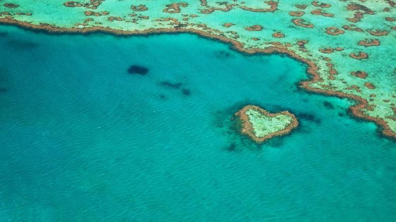 Heart-shaped reef around the Great Barrier Reef, Queensland, Australia.