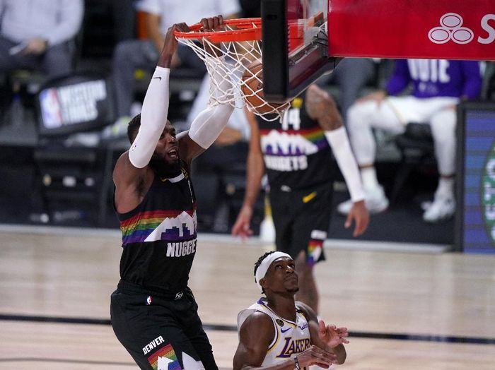 Denver Nuggets forward Paul Millsap (4) dunks over Los Angeles Lakers Rajon Rondo (9) during the second half of Game 3 of the NBA basketball Western Conference final Tuesday, Sept. 22, 2020, in Lake Buena Vista, Fla. (AP Photo/Mark J. Terrill)