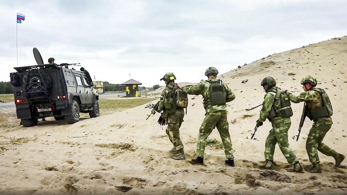 In this photo taken from a footage released on Sept. 22, 2020 by Russian Defense Ministry Press Service, Paratroopers attend a military exercises at the Ashuluk military base in Southern Russia. Russian Air Defense systems successfully repelled aerial strike during joined military drills in the south of Russia. The drills, expected to be held in Black Sea and Caspian sea waters, will take place until September 26th. Belarus, Armenia, China, Pakistan and Myanmar take part in the exercises.