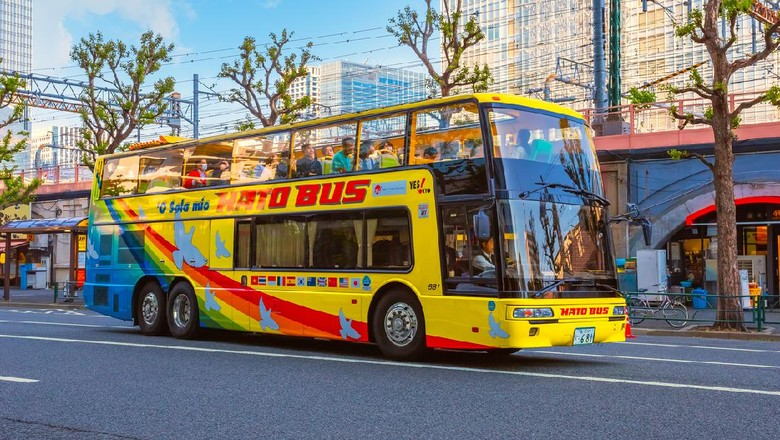 Tokyo, Japan - April 28 2018: Hato Bus goes around the Tokyo sightseeing spots with both English and Chinese speaking guide, its one of the best ways to enjoy  Tokyo citys surrounding