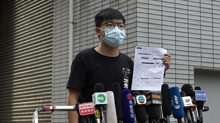 Hong Kong pro-democracy activist Joshua Wong displays a bail paper outside the Central Police Station in Hong Kong, Thursday, Sept. 24, 2020. Wong said he was arrested again Thursday for allegedly participating in an unauthorized assembly last October. (AP Photo/Vincent Yu)