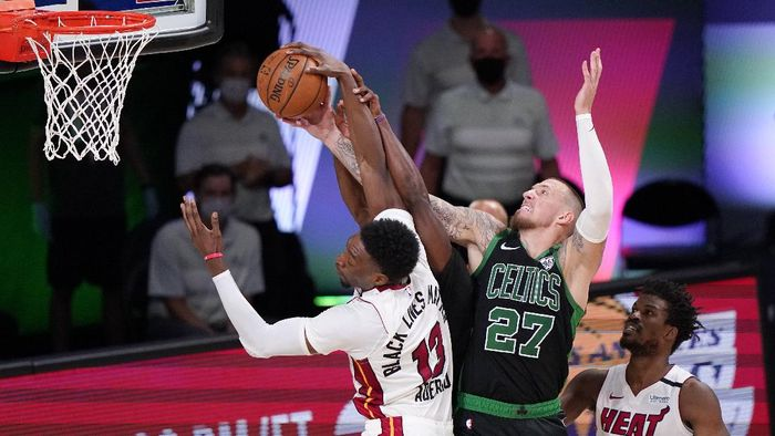 Miami Heats Bam Adebayo (13) and Boston Celtics Daniel Theis (27) battle for the ball during the second half of an NBA conference final playoff basketball game Friday, Sept. 25, 2020, in Lake Buena Vista, Fla. (AP Photo/Mark J. Terrill)