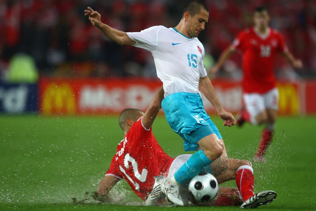 BASEL, SWITZERLAND - JUNE 11: Eren Derdiyok of Switzerland tackles Emre Asik of Turkey  during the UEFA EURO 2008 Group A match between Switzerland and Turkey at St. Jakob-Park on June 11, 2008 in Basel, Switzerland.  (Photo by Laurence Griffiths/Getty Images)