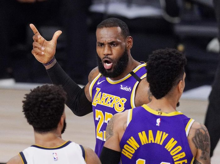 Los Angeles Lakers LeBron James (23) voices his opinion after a play in the second half of an NBA conference final playoff basketball game against the Denver Nuggets Saturday, Sept. 26, 2020, in Lake Buena Vista, Fla. (AP Photo/Mark J. Terrill)