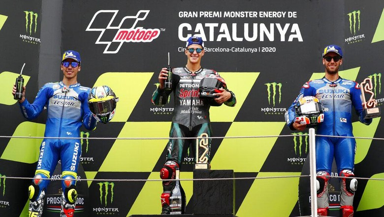 Second placed Joan Mir of Spain, winner Fabio Quartararo of France and third placed Alex Rins of Spain, from left to right, pose on the podium of the MotoGP race of the Catalunya Motorcycle Grand Prix at the Barcelona Catalunya racetrack in Montmelo, near Barcelona, Spain, Sunday, Sept. 27, 2020. (AP Photo/Joan Monfort)